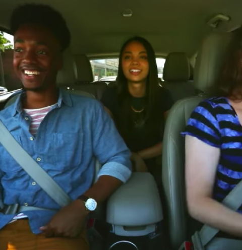 Three young people in a car