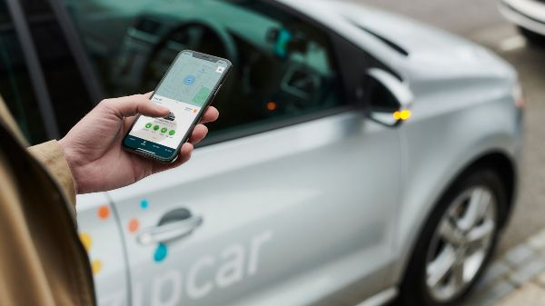 unlocking a zipcar with an app on a phone