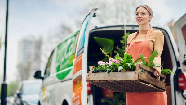 woman delivering flowers in a zipcar van