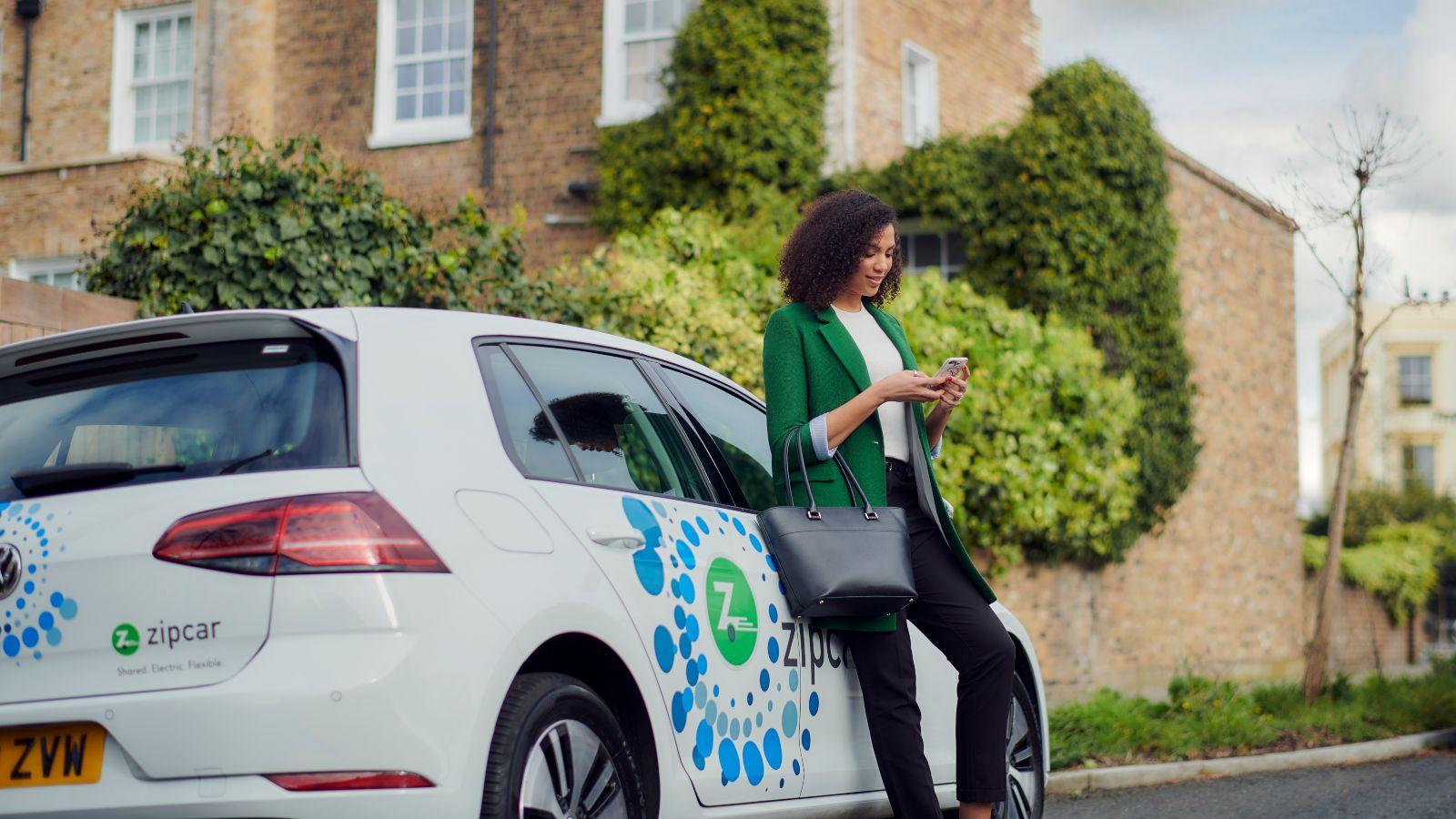 Woman renting a Zipcar electric car