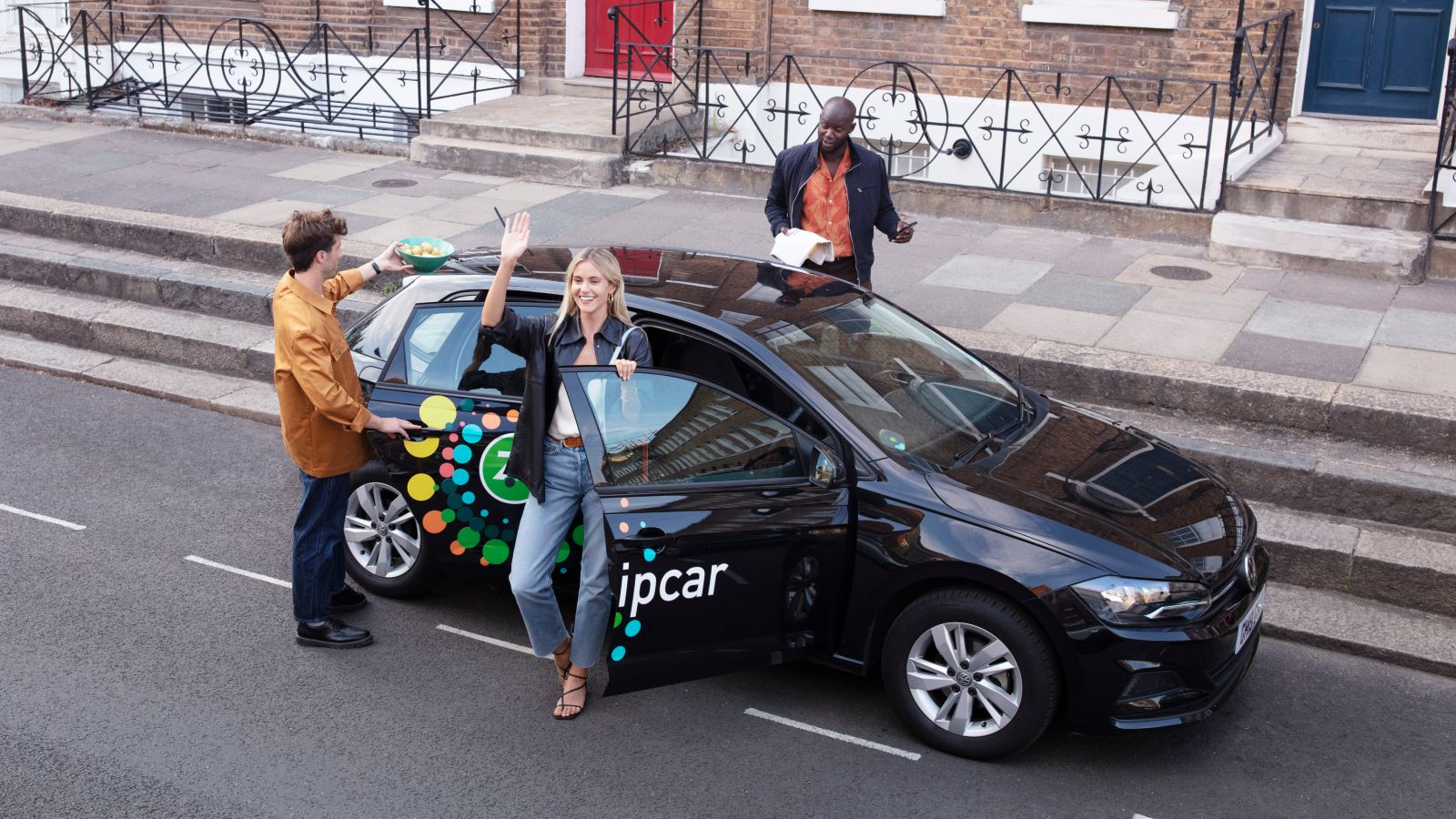 Friends using a Zipcar for more sustainable travel