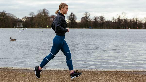 woman running around a pond