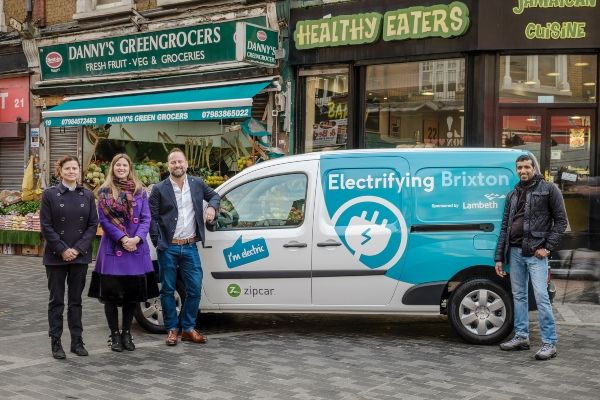 Zipcar GM, James Taylor, and members of Lambeth council standing next to the electric Zipcar van