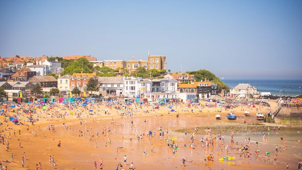 broadstairs beach filled with people on a sunny day