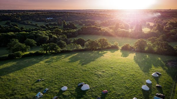 aerial view of idyllic campsite at sunset with north london countryside