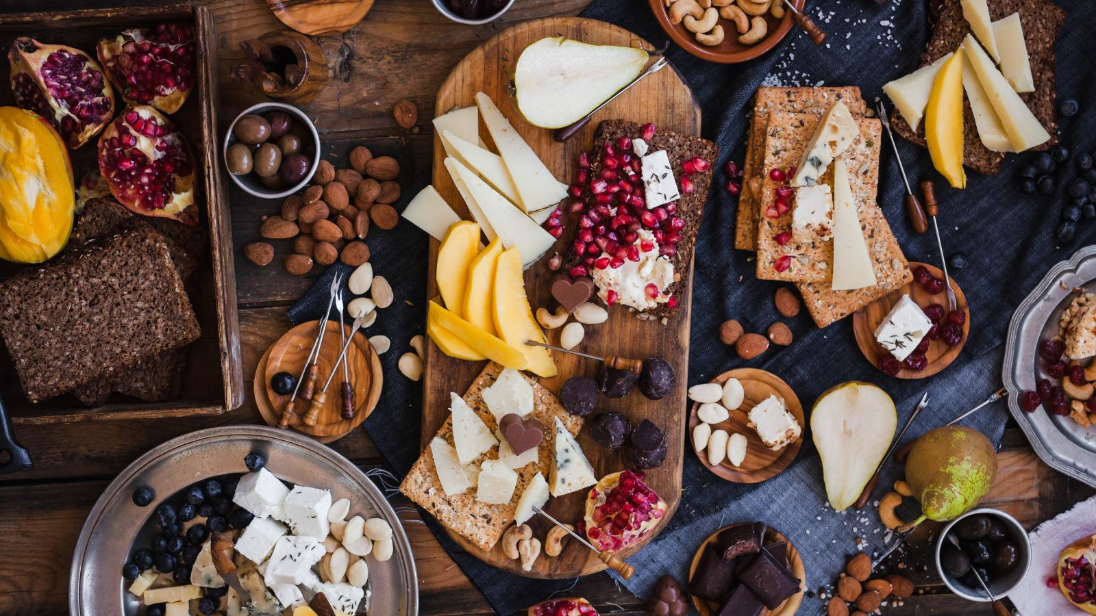 cheese board with breads and fruits