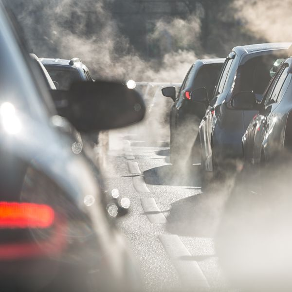 idling cars with visible exhaust fumes