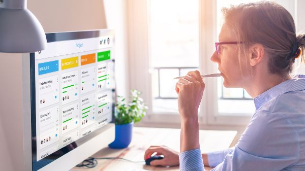 woman using project management software at a desk