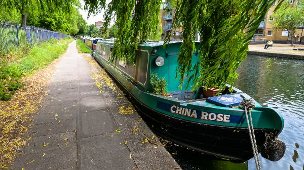 a canal boat moored on the river lea