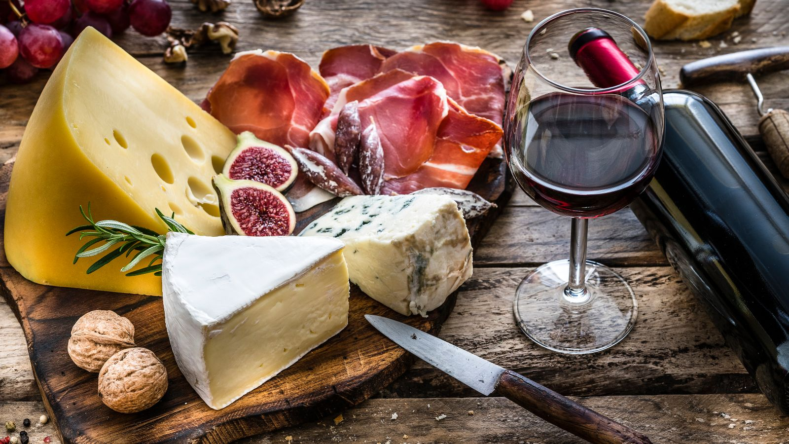 cheese board with a glass of wine