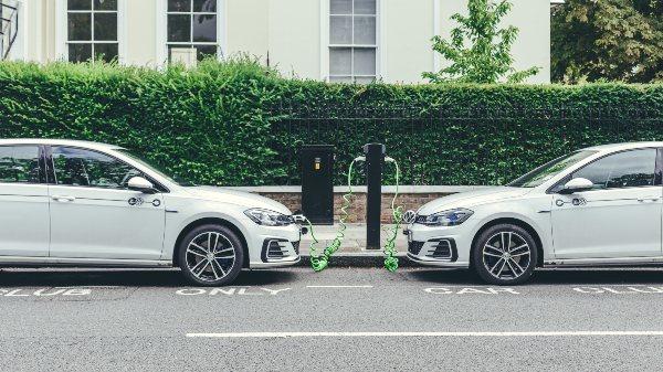 2 zipcar electric vehicles charging