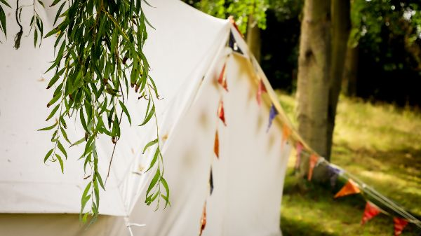 bell tent with bunting in a glamping field