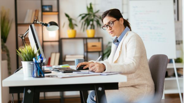 focused woman sat at her desk working