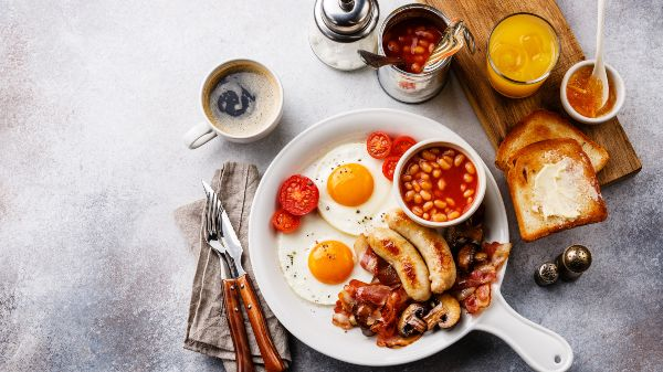 big full english breakfast with coffee and juice on the side