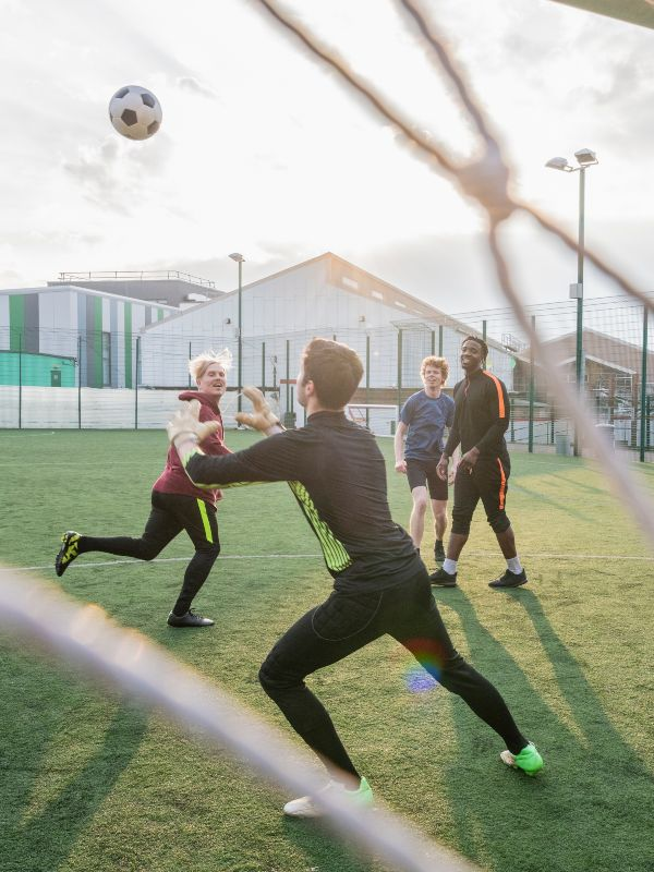 group of people playing football outside
