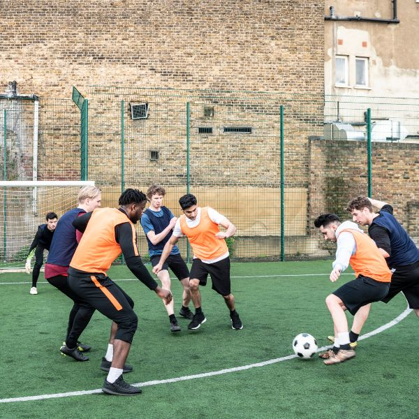 a group of men playing 5-a-side football