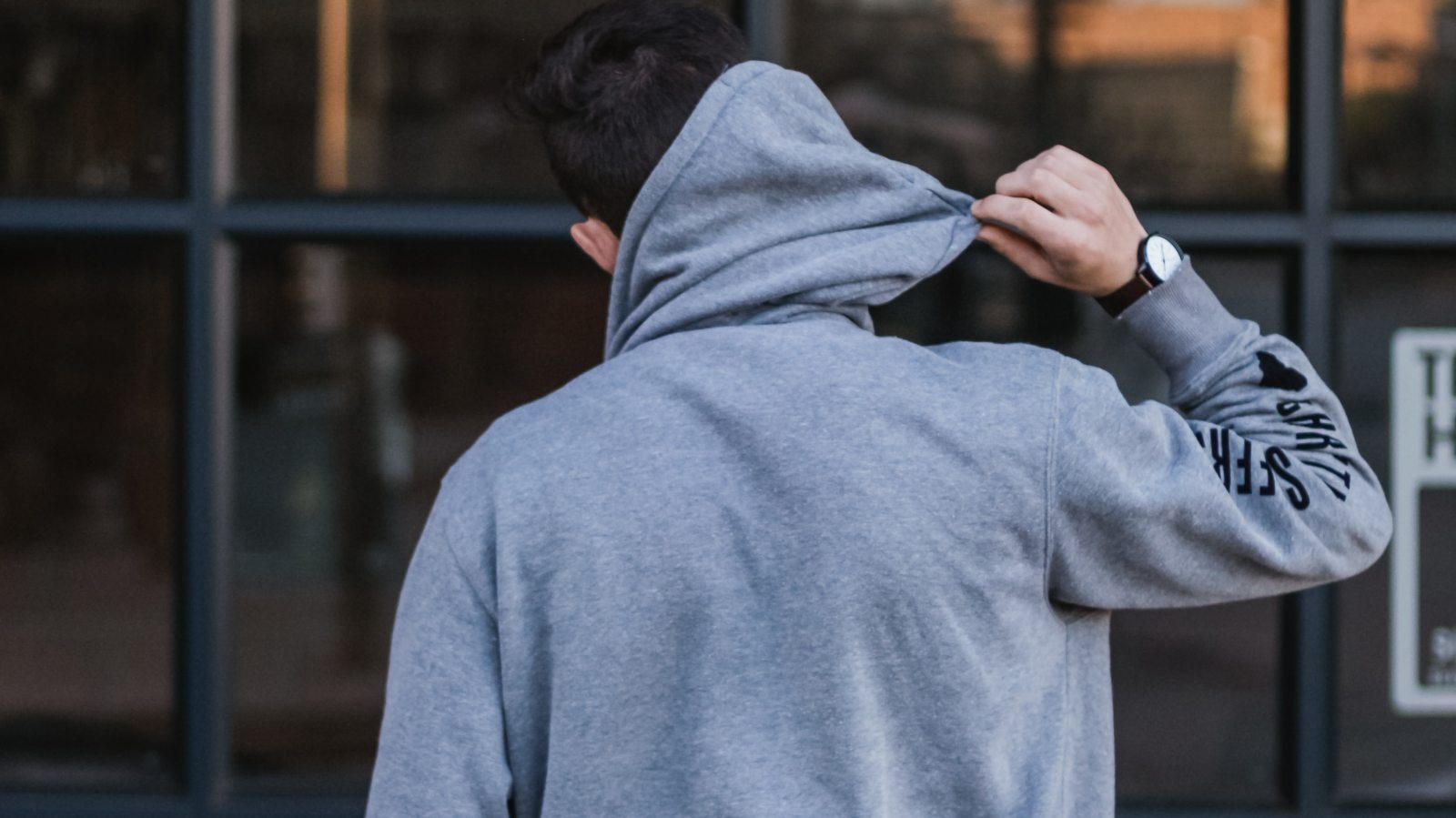 putting on a hoody